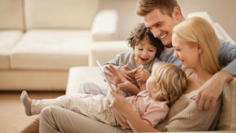 a young family looking at tablet together